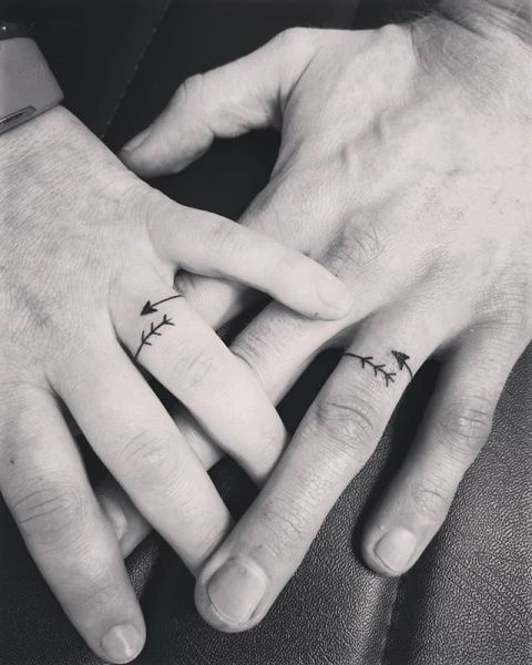 relationship tattoos with arrows on ring finger