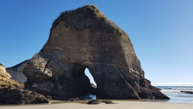 Giant rock arches on Wharariki Beach