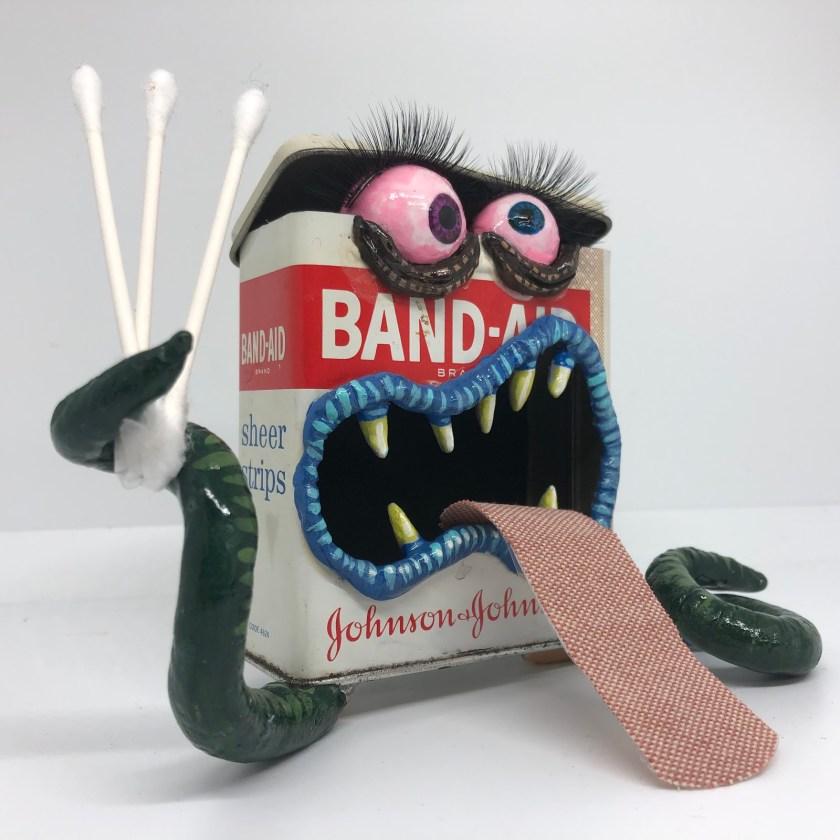 Steve Casino band-aid tin monster art