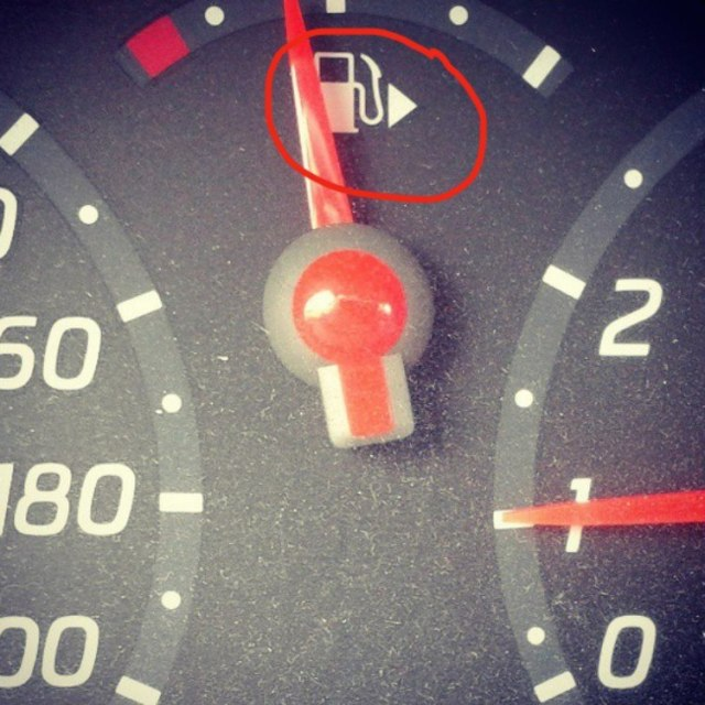Gas tank arrow on the dashboard.