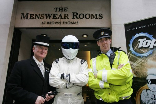 Conceirge Ciaran Bass with the Stig and Garda Hugh Shovlin outside the Brown Thomas Store on Wicklow Street
