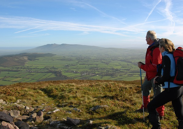 Walkers Looking across the Golden Vale from the summit of Blackrock on the Ballyhoura Mountains