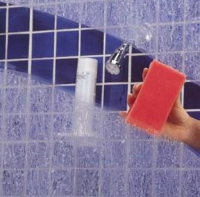 hard water spots on a glass shower door