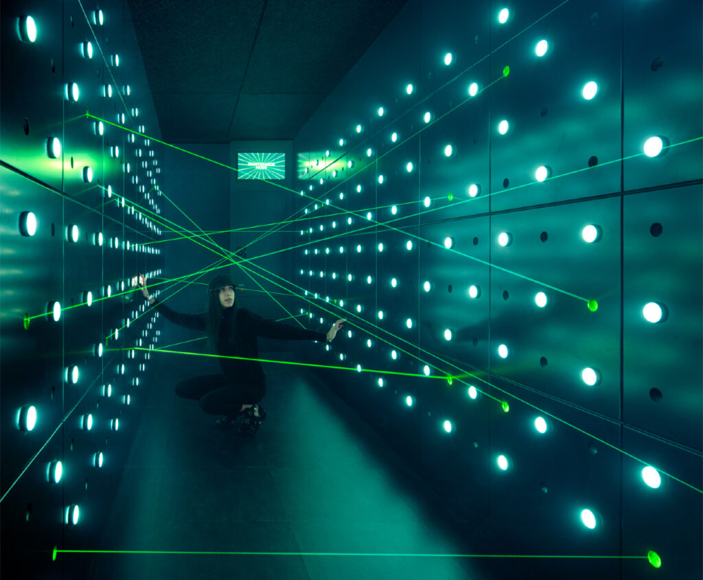 Woman kneeling down in laser beam challenge