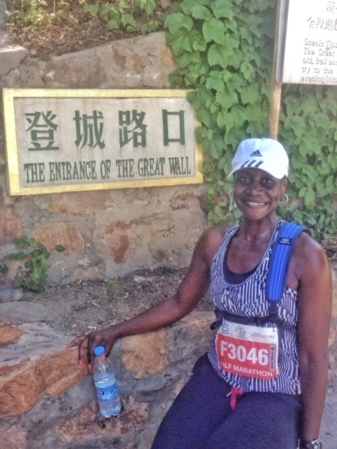 Monique posed after running the Great Wall of China while on holiday