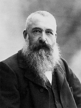 A photograph of Claude Monet in his later years, a serious-looking man with soulful eyes and a magnificent beard.