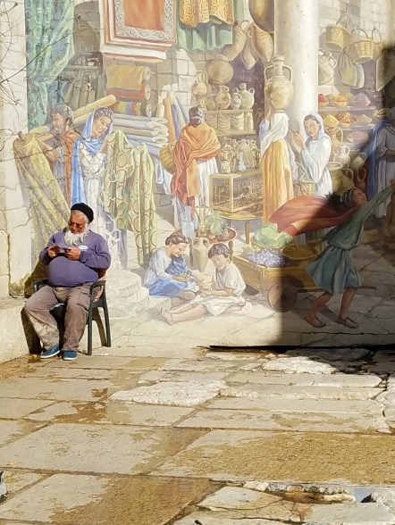 This Palestinian gentleman reads an Arabic gospel tract near the Dung Gate.