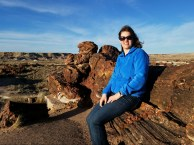 Anna sits on a huge petrified tree