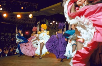 Margaret Kelly Dancers of England performing French Cancan routine on stage at the Moulin Rouge nightclub.