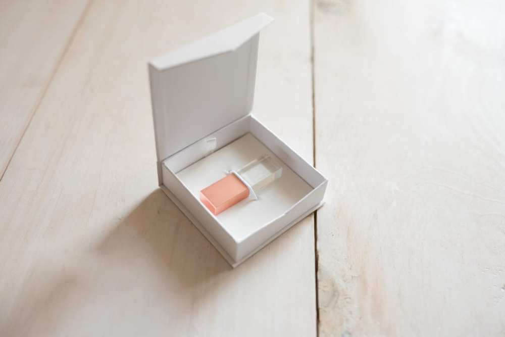 Crystal USB in Brushed Rose Gold with the box perfect for storing your digital images on with custom inset engraving