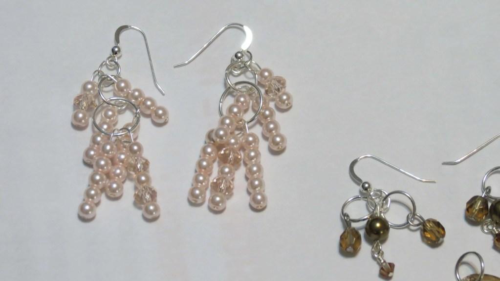 Pink pearl & crystal earrings.