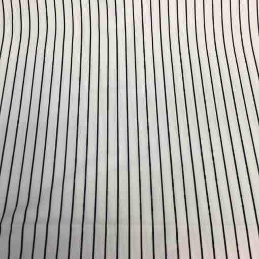 Lycra imprimé fond blanc ligne noir