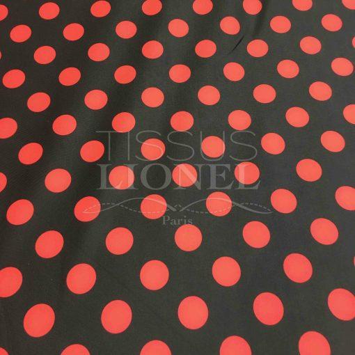 Lycra imprimé pois rouge sur fond noir