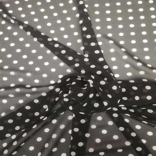 Tissu mousseline fond noir pois blanc