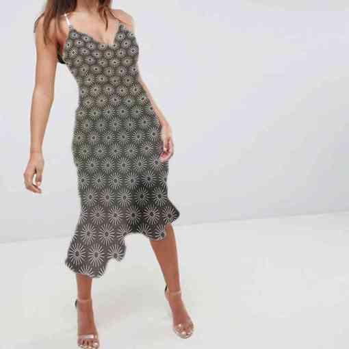 Tissu coton motif soleil gris robe