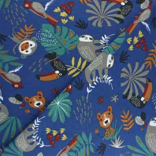 Tissu jersey de coton jungle bleu