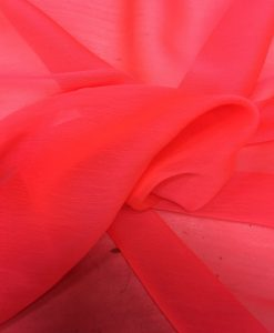 Tissu mousseline corail fluo clair