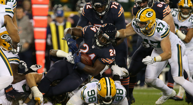 GREENBAY, WI - OCTOBER 20: Running back Jordan Howard #24 of the Chicago Bears carries the ball against defensive end Letroy Guion #98 and inside linebacker Jake Ryan #47 of the Green Bay Packers in the first quarter at Lambeau Field on October 20, 2016 in Green Bay, Wisconsin. (Photo by Dylan Buell/Getty Images)