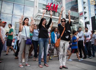 At this very moment، Antiwar Freeze Flash Mob toronto- July 26, 2014 Photo By Bahare Khodabande