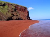 Red Sand Beach, Rabida, Galapagos. The red sand at Rabida was formed due to the oxidization of iron-rich lava deposits, although it could also be due to washed-up coral sediments.
