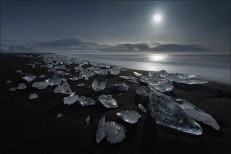 Jokulsarlon, Iceland. The black volcanic sand on this Icelandic beach contrasts beautifully with the white and glassy chunks of ice.Image credits: D-P Photography