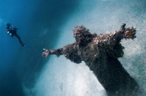 Christ of the Abyss - San Fruttuoso, Italy. Guido Galletti built this statue of Christ in 1954 and placed it into the water at a depth of 55 feet.