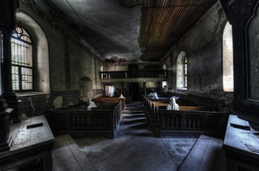 "Photo By Niki Feijen""Church of the 9 Ghosts"" - An abandoned church inhabited by nine 'ghosts' sitting in the pews dressed in wrinkly white cloths. Spooky.."