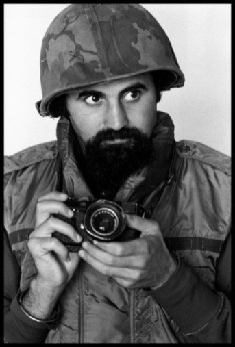 SOUTH VIETNAM. 1973. Photographer ABBAS wears helmet and flack-jacket while covering the war.