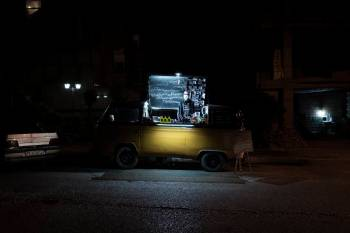 Gorgan, Iran - APRIL 21:Ali , 25 and Hamid, 27, from Gorgan ,have bought a van cafŽ and every night one of them is responsible for selling and doing things. But after the outbreak of Corona virus (COVID-19), their sales have been reduced to one third. TheyÕre too weak to make a living. Their income is 70 thousand tomans, approximately equal to 5 dollars.Iran is amongst five of the countries with the highest spread of COVID-19. IranÕs government began an official lockdown on March 15th, 2020, the quarantines in place are for those who do not exhibit symptoms but have been exposed to the illness. For the large number of Iranians who live on a day by day income, staying home, means having no money to pay for essential things such as food. Therefore, they must take their life in their own hands and work in order to survive even at the risk of getting infected, spreading the virus in society at large, and even getting fined for breaking the quarantine. For them, choosing either path has extreme consequences. (Photo by Kianoush Saadati/NVP Images)