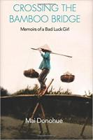 Cover for Crossing the Bamboo Bridge Memoirs of a Bad Luck Girl by Mai Donahue picturing a woman crossing a bridge holding two full baskets tided to a large stick