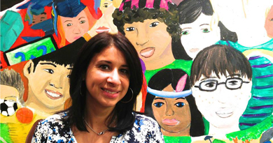 Photo of a well dressed woman in front of a mural of children of many different races