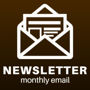 newsletter monthly email icon. white envelope over brown background