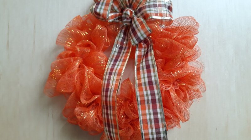 orange fall wreath of wire and ribbons