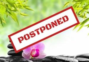 postponed text over zen imagery