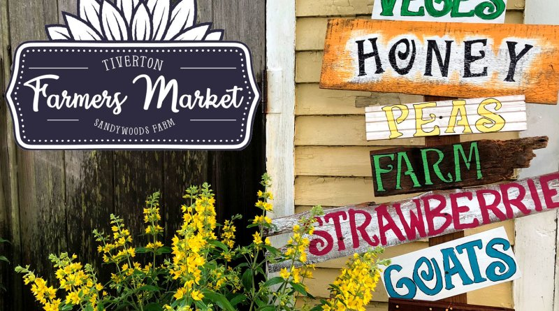signs on the wall at the farmers market