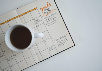 calendar and coffee planning with a cup of joe
