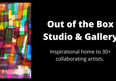Out of the Box Studio & Gallery is the inspirational home to 30+ collaborating artists. a rainbow multicolor painting of geometric shapes is on display against a black background