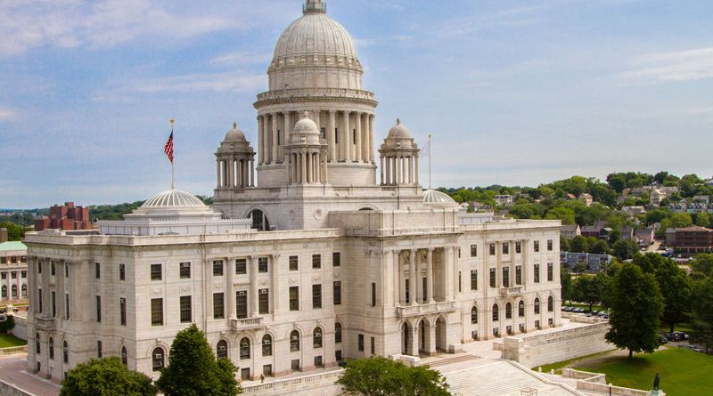rhode island state house building in providence white building green grass lawn city in the background