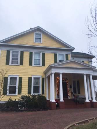 the front of Six Acres yellow house