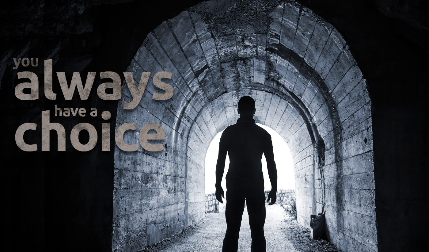 daily inspirational quote image: man standing in a dark tunnel, looking at the bright light ahaed