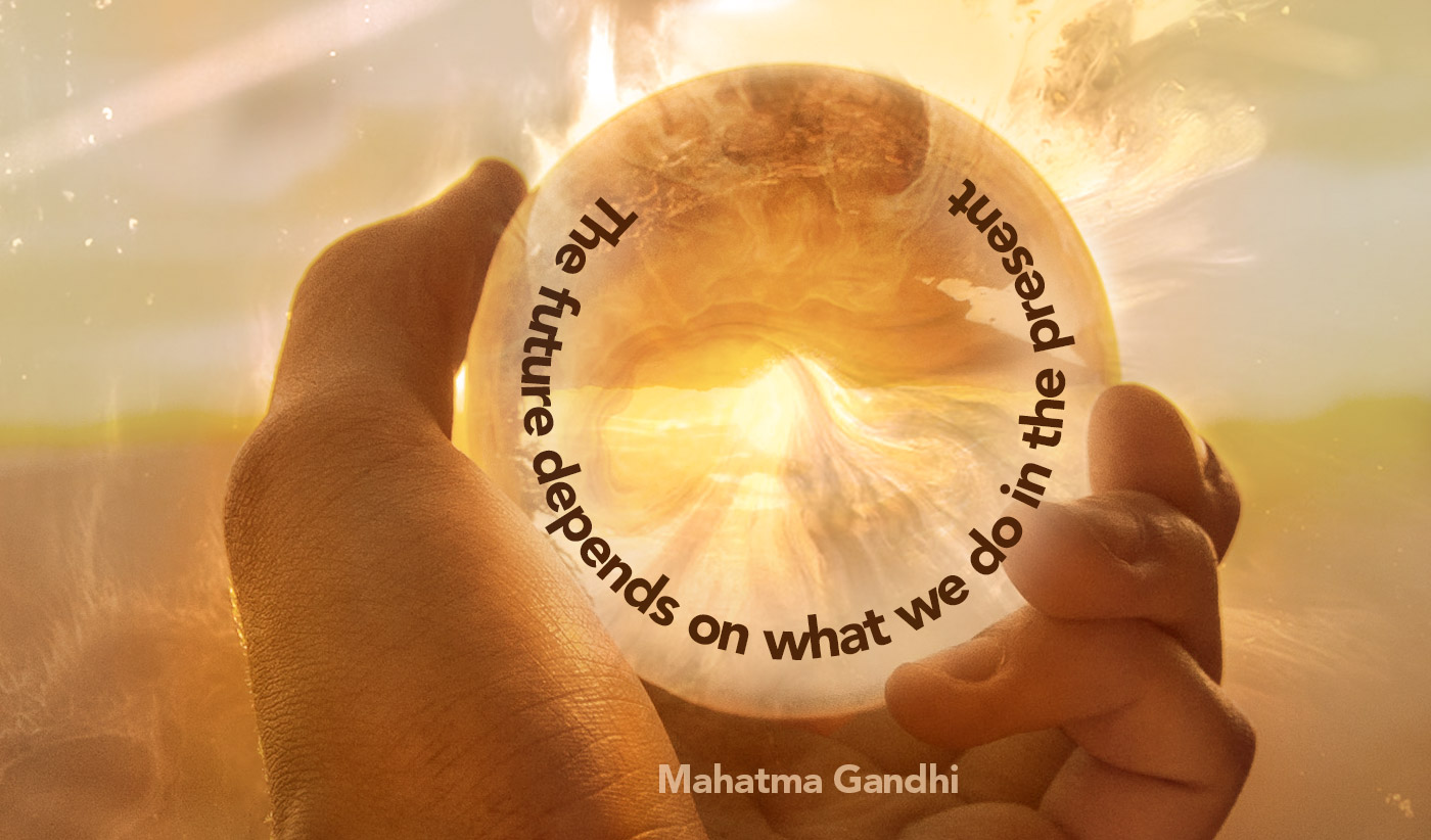 daily inspirational quote image: a hand holding a crystal ball reflecting beautiful, warm light
