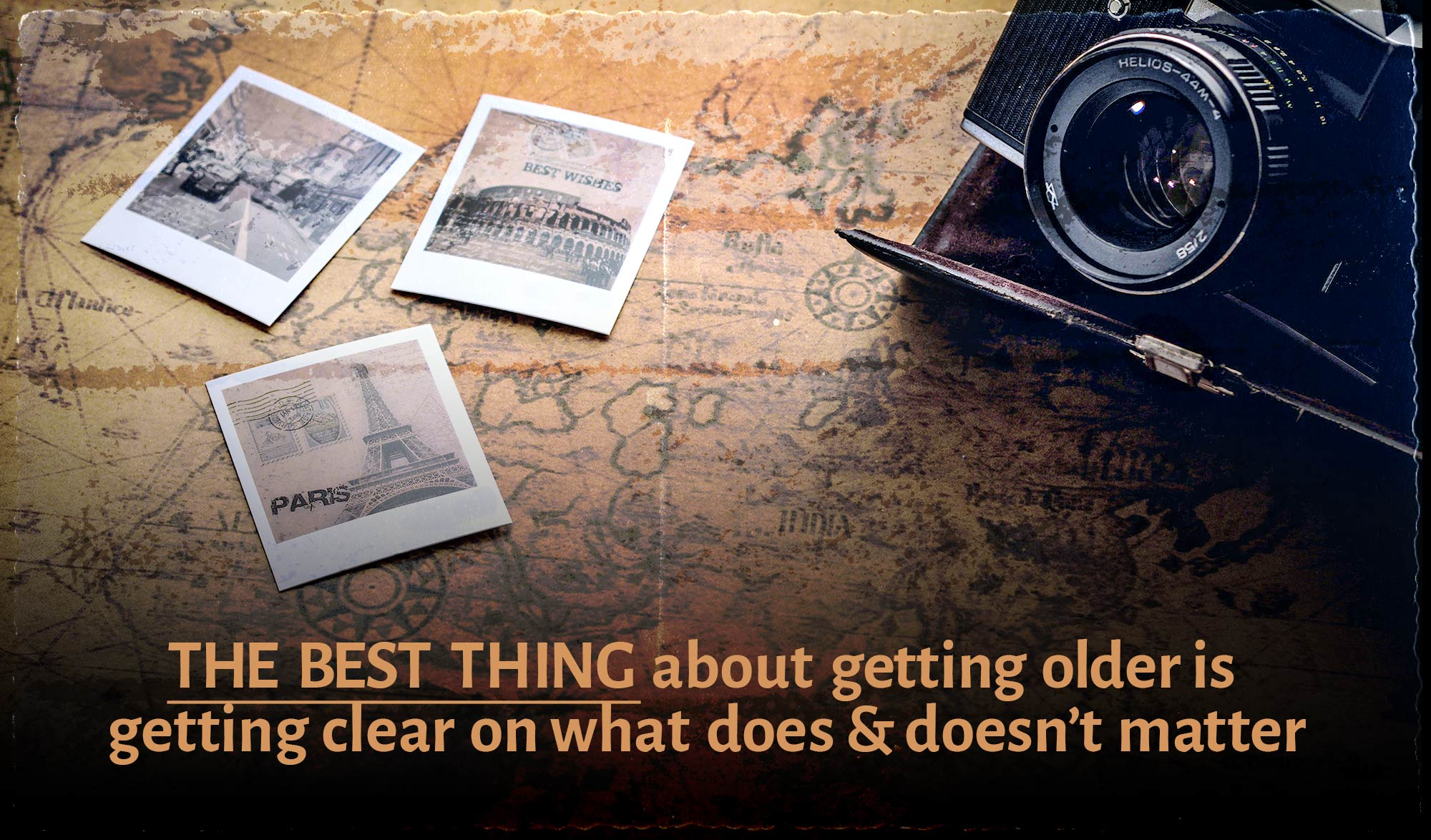 daily inspirational quote image: a table with an old map, a traditional SRL camera and polaroids