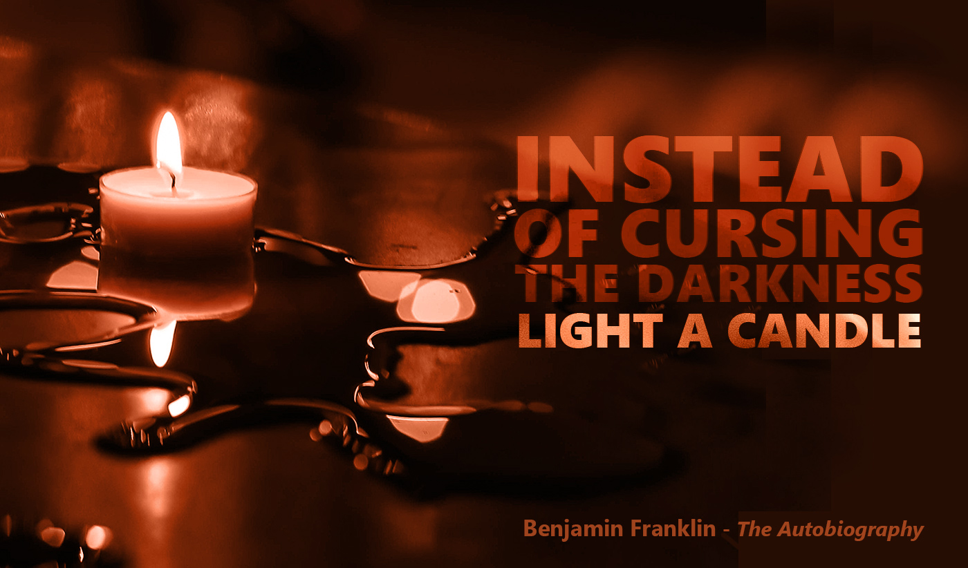 daily inspirational quote image: a tea light shining in a dark background