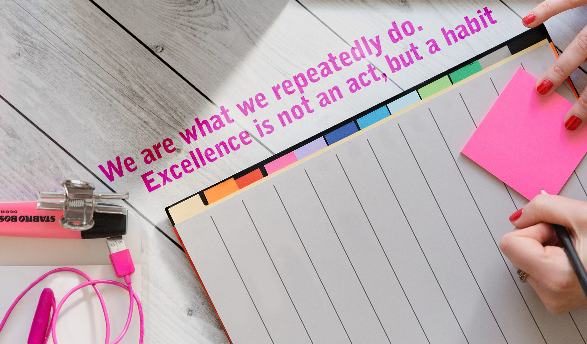 daily inpsirational image quote: top down view on a planner and a left-handed woman holding a pencil