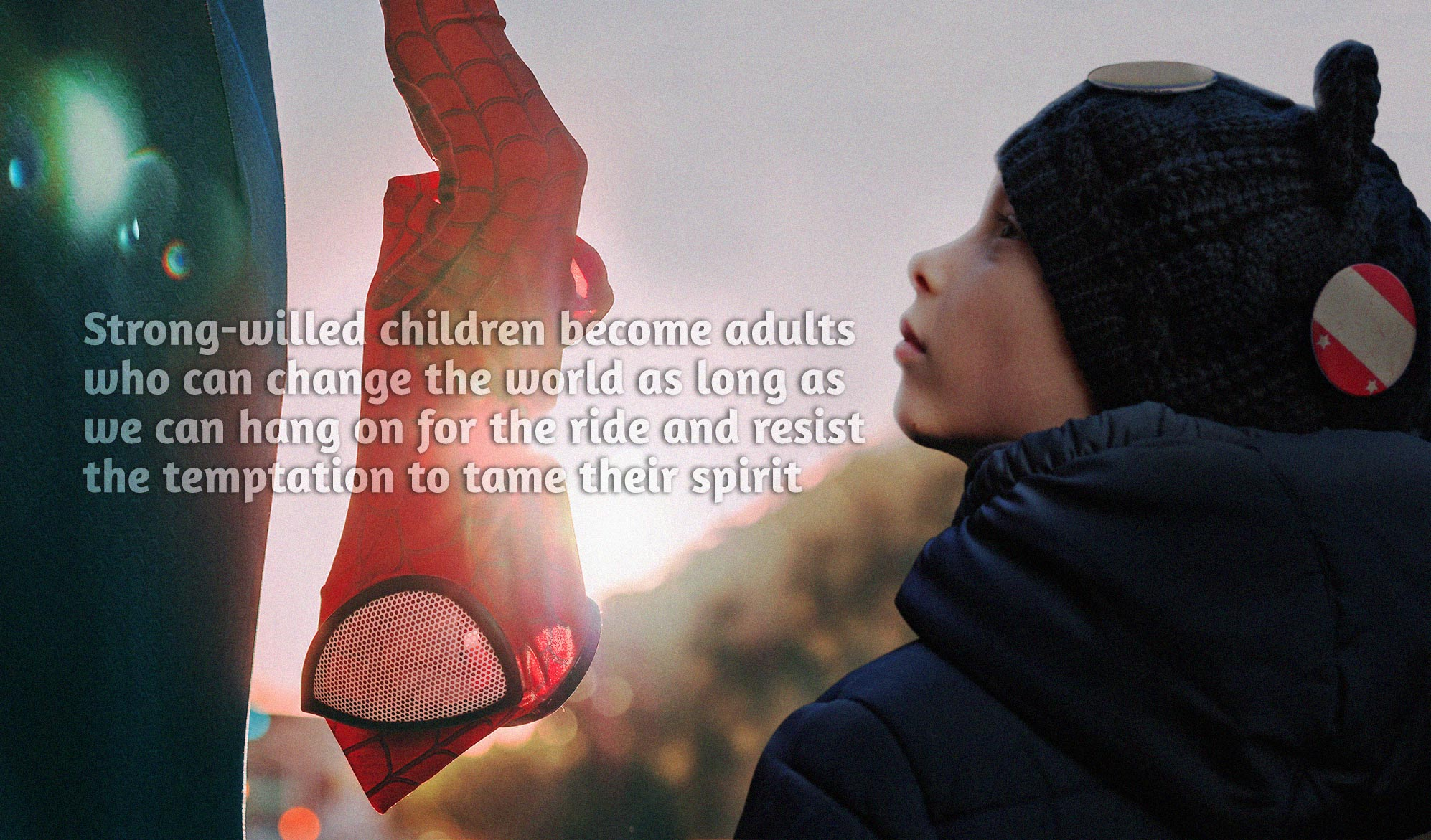 daily inspirational quote image: a boy looking up to a man dressed as superman at sunset