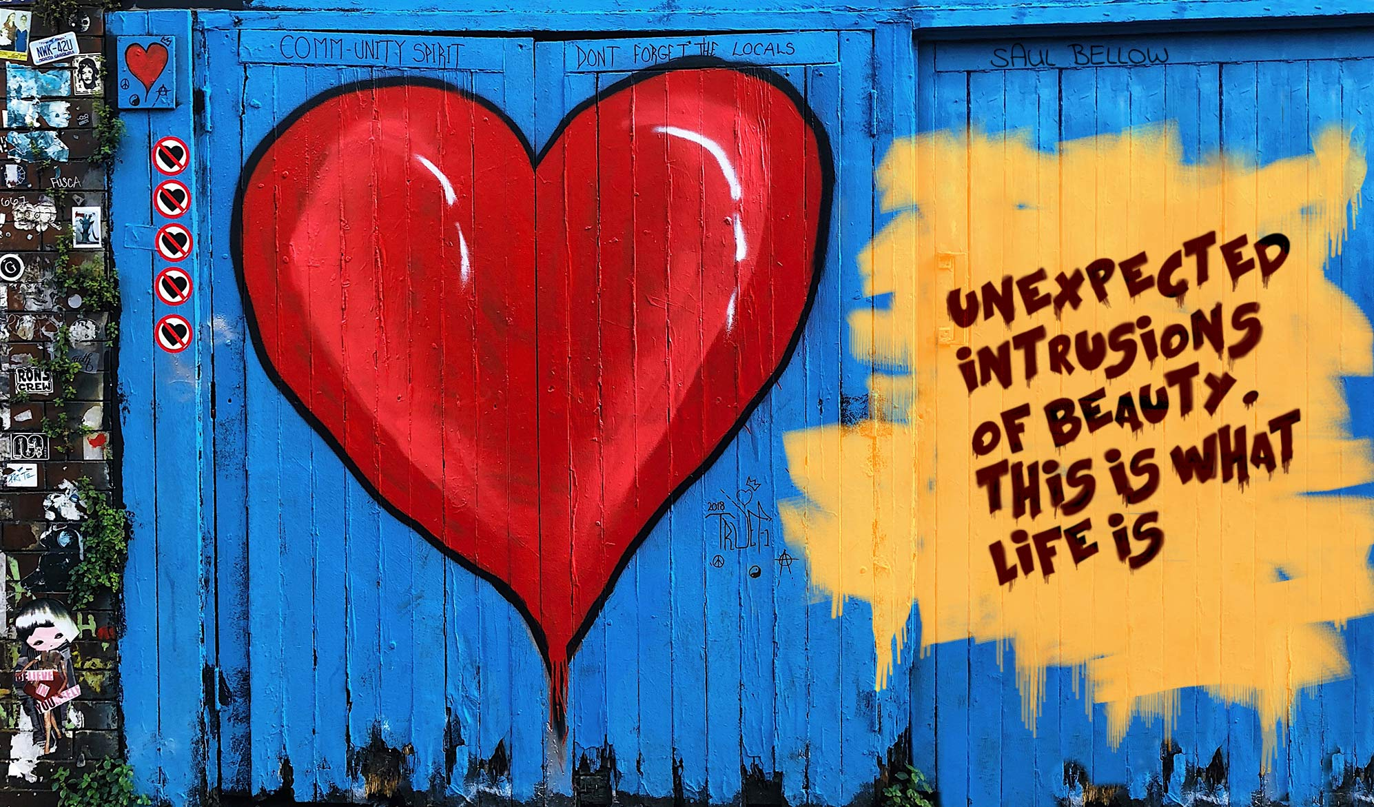 Daily inspirational quote image: a blue wooden fence with a heart and some text spray-painted on it