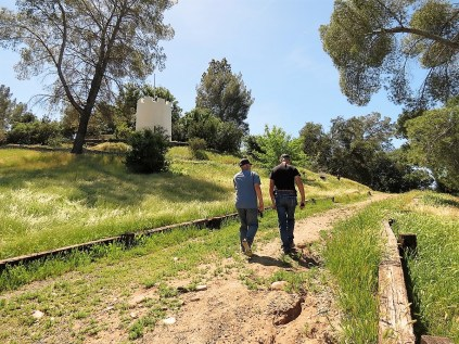 John and Len, who came with us, walking up the hill to the mansion.