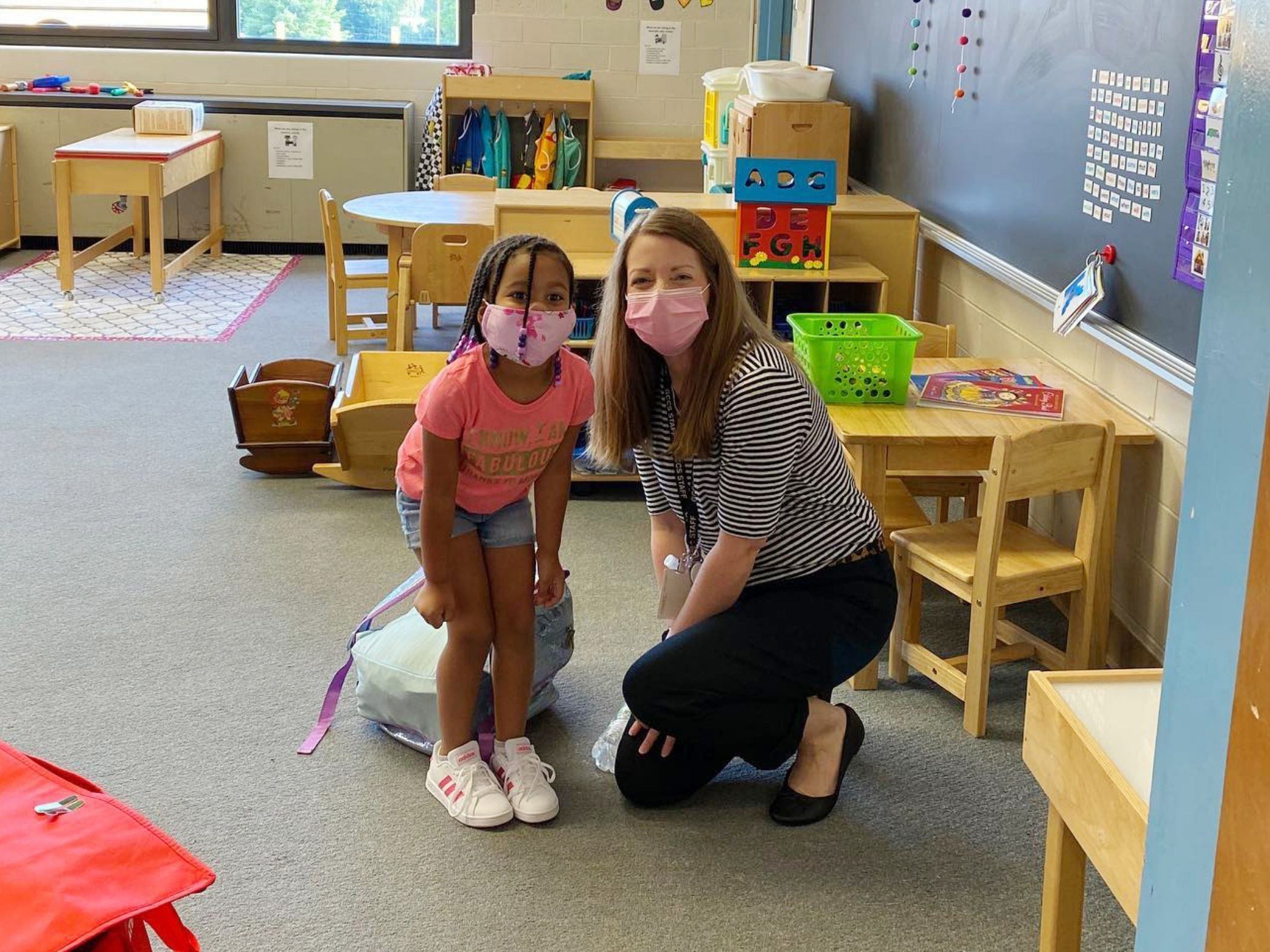 Student and teacher pose for camera