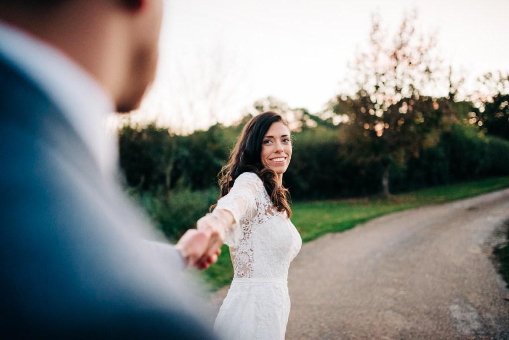 Kent Bride leading groom away