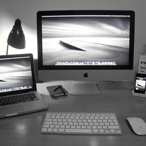 A photo of a home office full of Apple products.